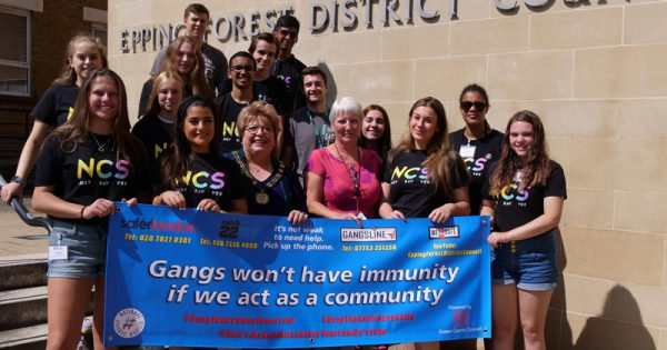 Cllr Kane with young people and banner