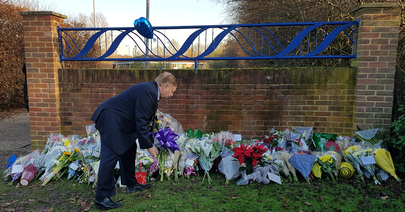 Chairman Richard Bassett placing flowers at Debden Park