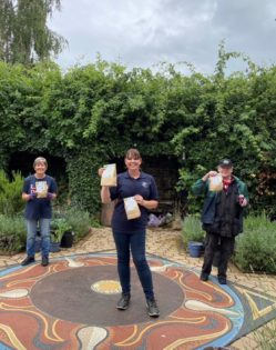 Victoria with gardening volunteers at the museum