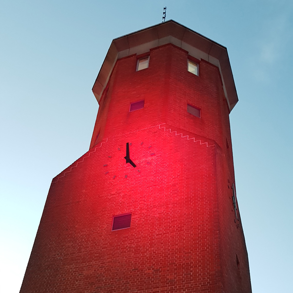 Tower at civic offices in Epping lit red