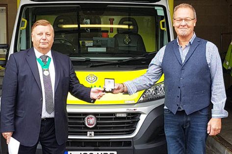 John Rout receiving the Community service medal for East of England Ambulance Service from Cllr Richard Bassett