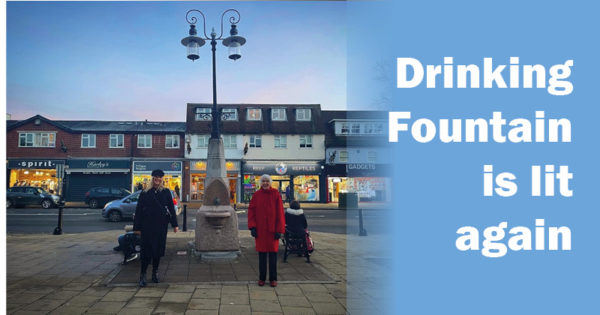 Councillor Holly Whitbread and former councillor Anne Miller standing in front of the drinking fountain in Epping High Street