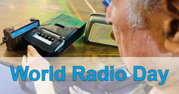 Resident looking at vintage radio