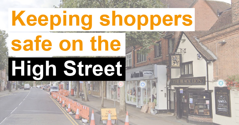 keeping shoppers safe on the high street - picture of Epping high street and temporary orange barriers