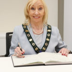 Vice-chairman Jo Share-Bernia signs the declaration of acceptance of office