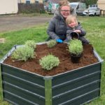 Stephanie Pearce and Olivia join in with the planting