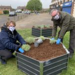 Kim and Andrew Smith planting