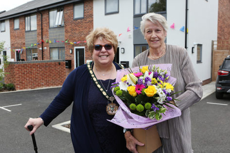 Shirley Hawkins and the chairman outside the new development